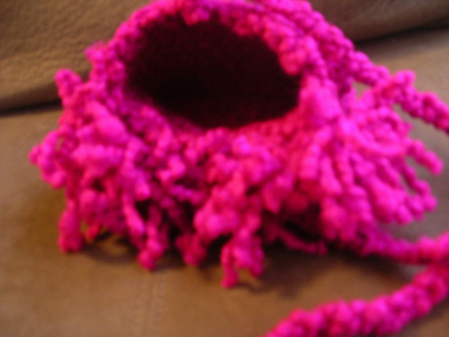 Hot pink purse with fluffy fringe
