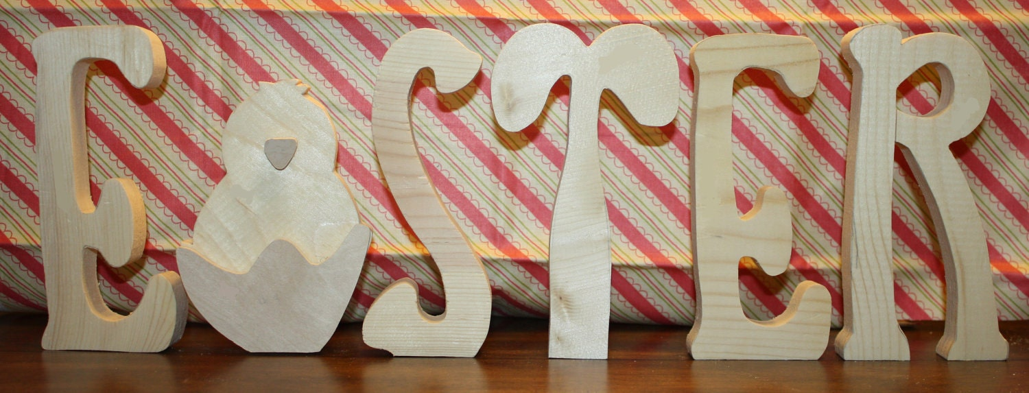 "UNFINISHED  Easter wood letters with chick as the ""A"" and rabbit as the ""T""."