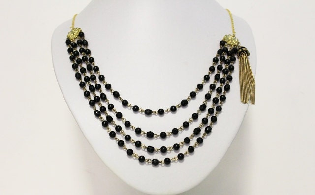 Handmade Recycled black and gold statement necklace with tassel detail