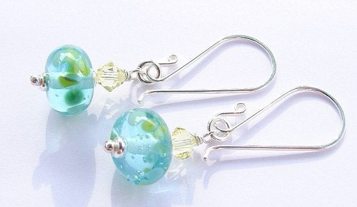 The lampwork beads were made by me using recycled glass from a Bombay Sapphire Gin bottle