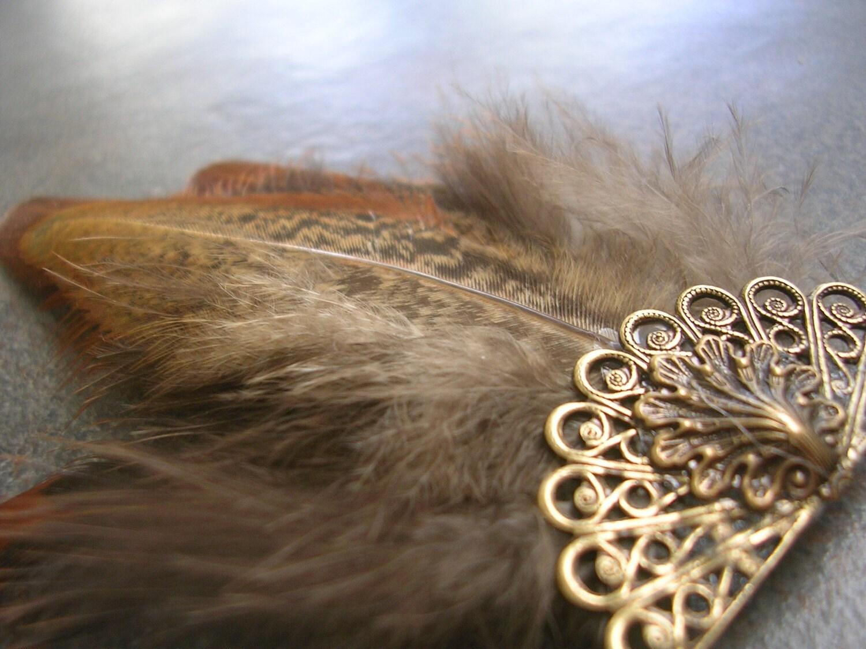 http://www.etsy.com/listing/66797068/hair-pin-fascinator-tribal-pheasant