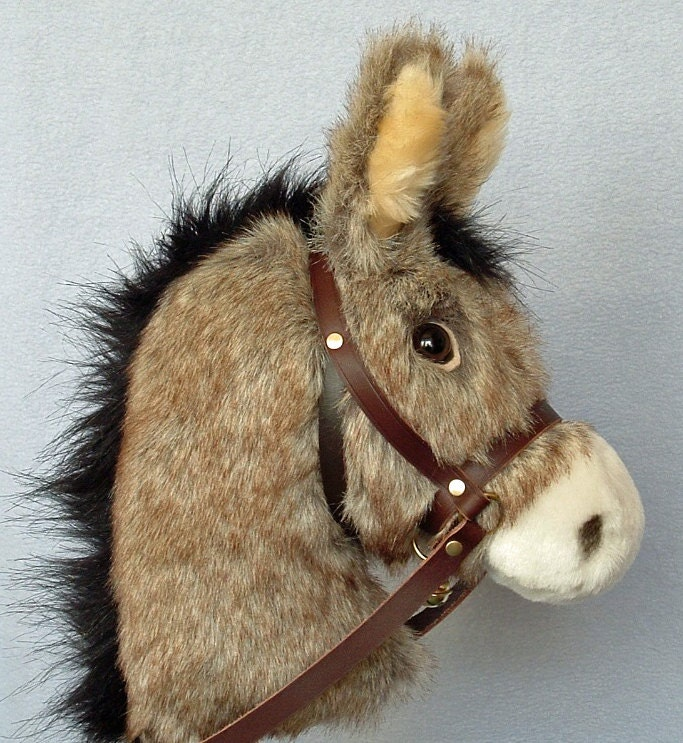Childs Hobby horse (stick horse) Donkey. Top quality plush fur fabric with hardwood pole wheels plus removable leather bridle with bell.
