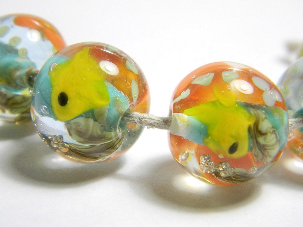 Each one is a little aquarium made with yellow, blue, orange, green and clear glass.