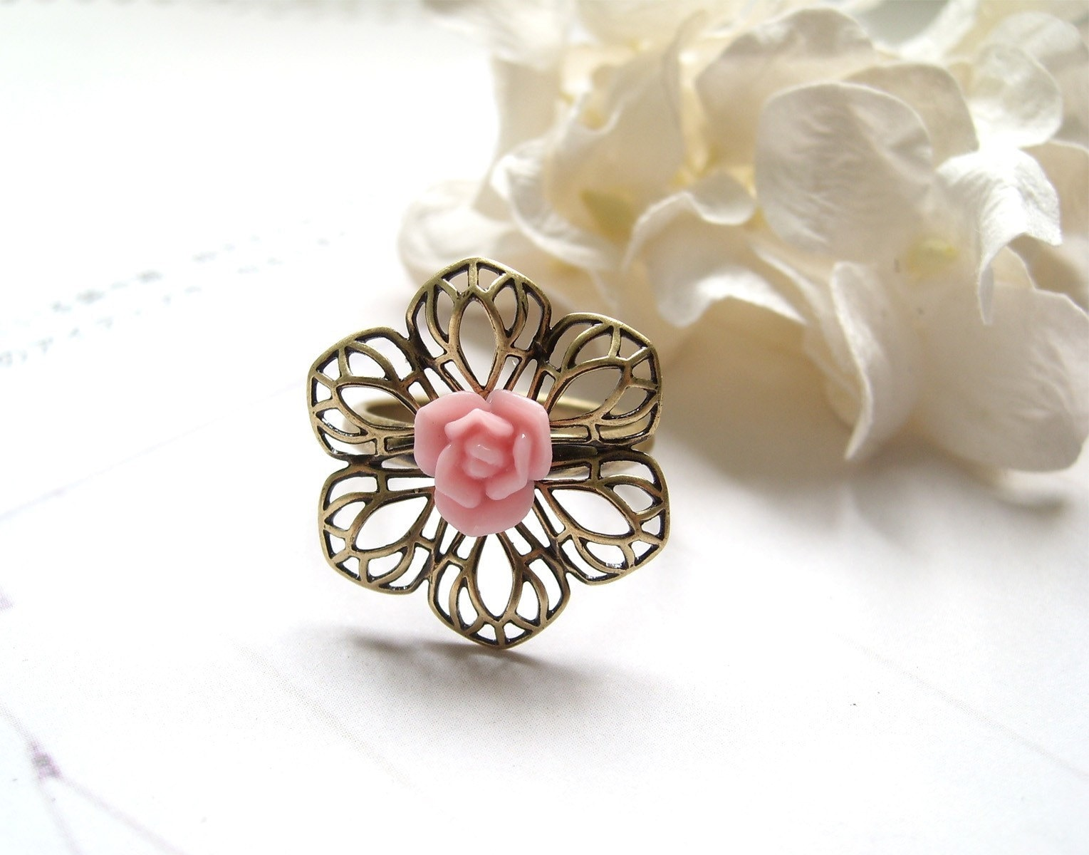 Gwen. Salmon pink rose bud with flower filigree antiqued brass adjustable ring