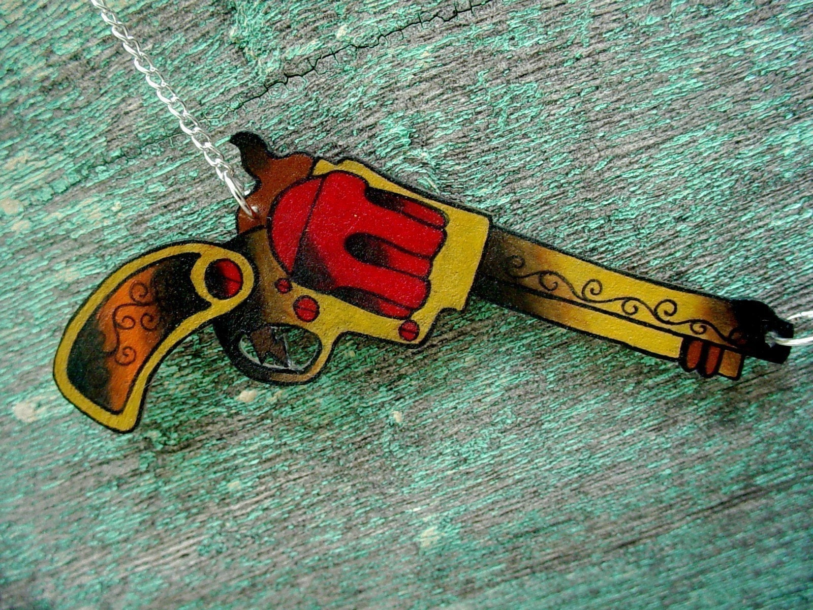 red gold and brown double vintage tattoo pistol necklace