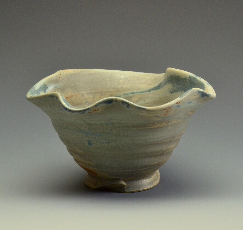 Bowl with undulating rim