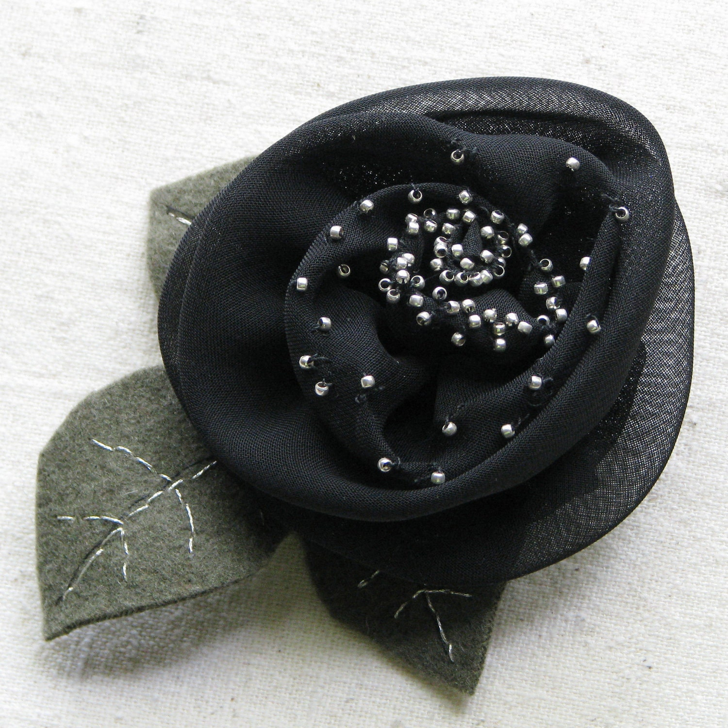 Black rose hair clip, chiffon fabric embellished with silver beads, embroidered moss green felt leaves, large
