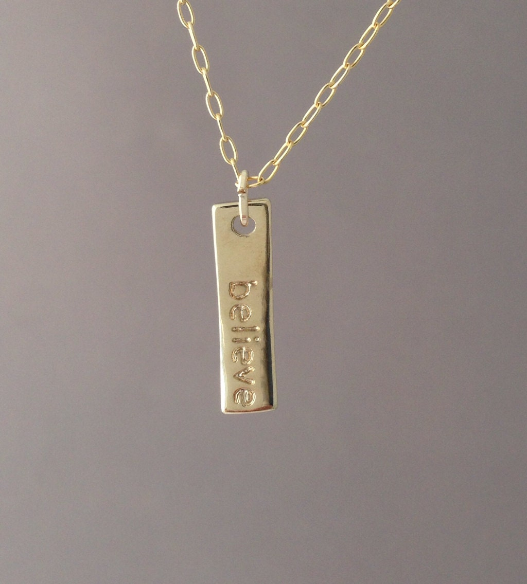 items similar to gold believe vertical bar necklace on etsy