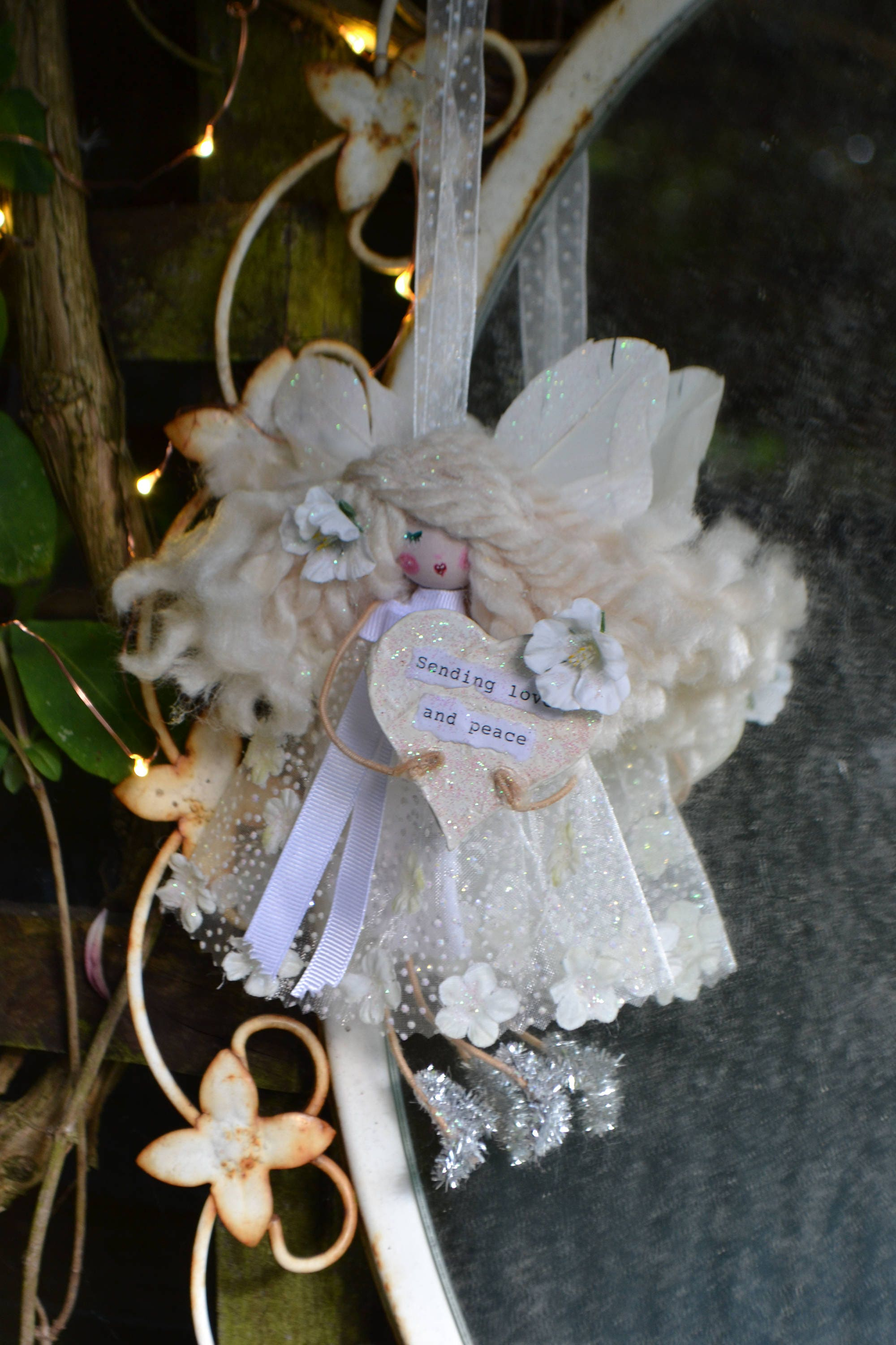 Guardian Angel Fairy doll. With message saying (Sending love and peace).