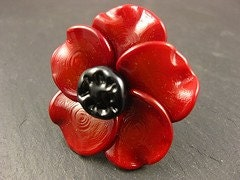 Wear a special poppy this year - this beauty is made from glass and shaped in the torch. It is attached to a sterling silver ring