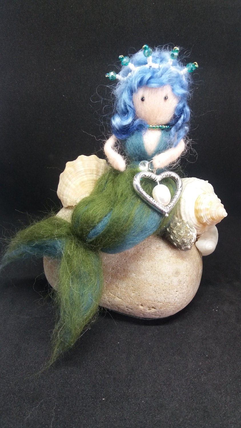 Little mermaid sitting on her pebble with heart and pearl. seaside home decoration mythical figure. woolfelt needle felt