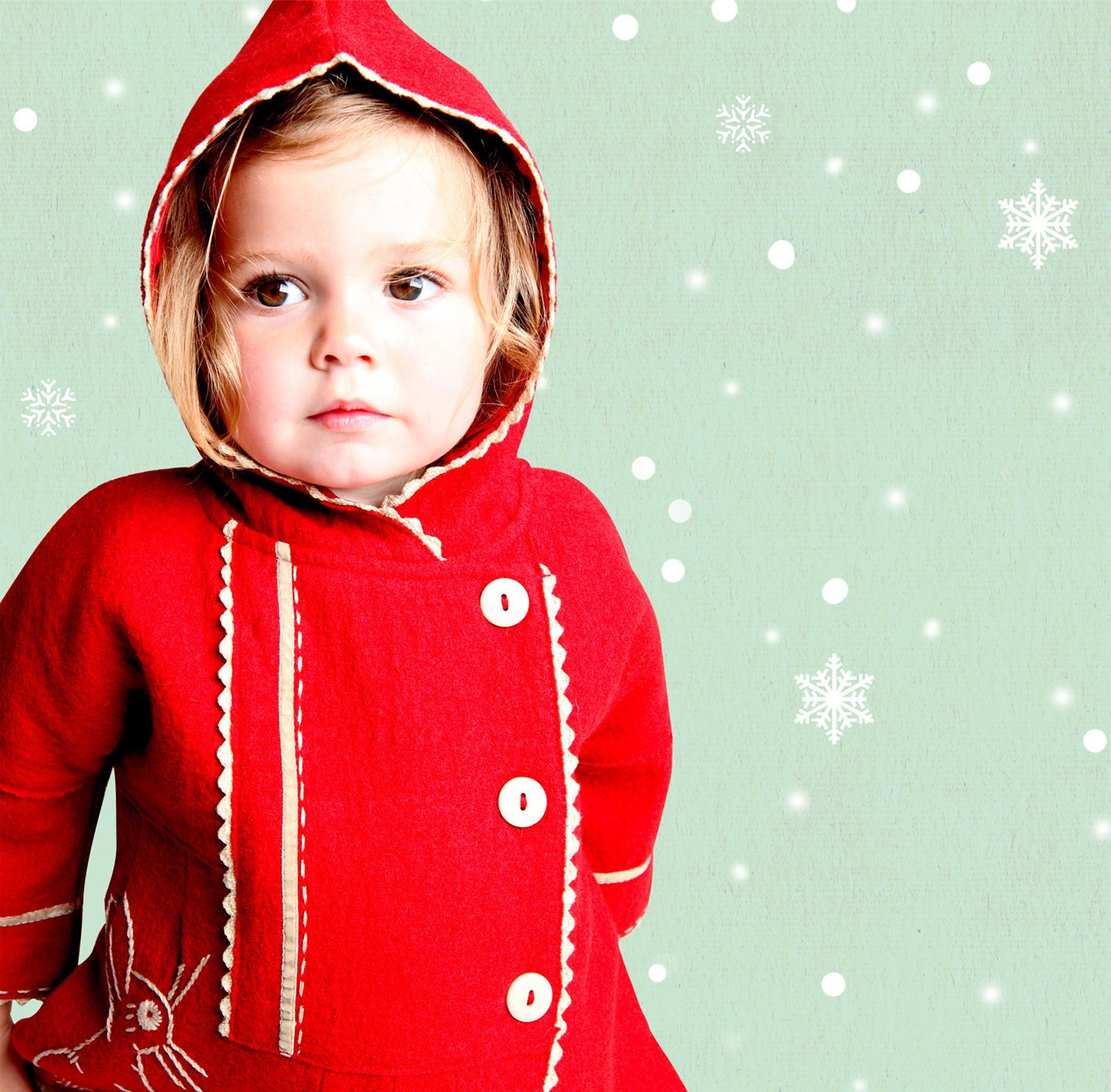 Little girl in read coat with bunny detail on the pocket
