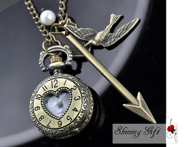 Hunger Games, Inspired Arrow,Bird, Mockingjay and Peeta Pearl Roman numerals Pocket watch Locket Necklace