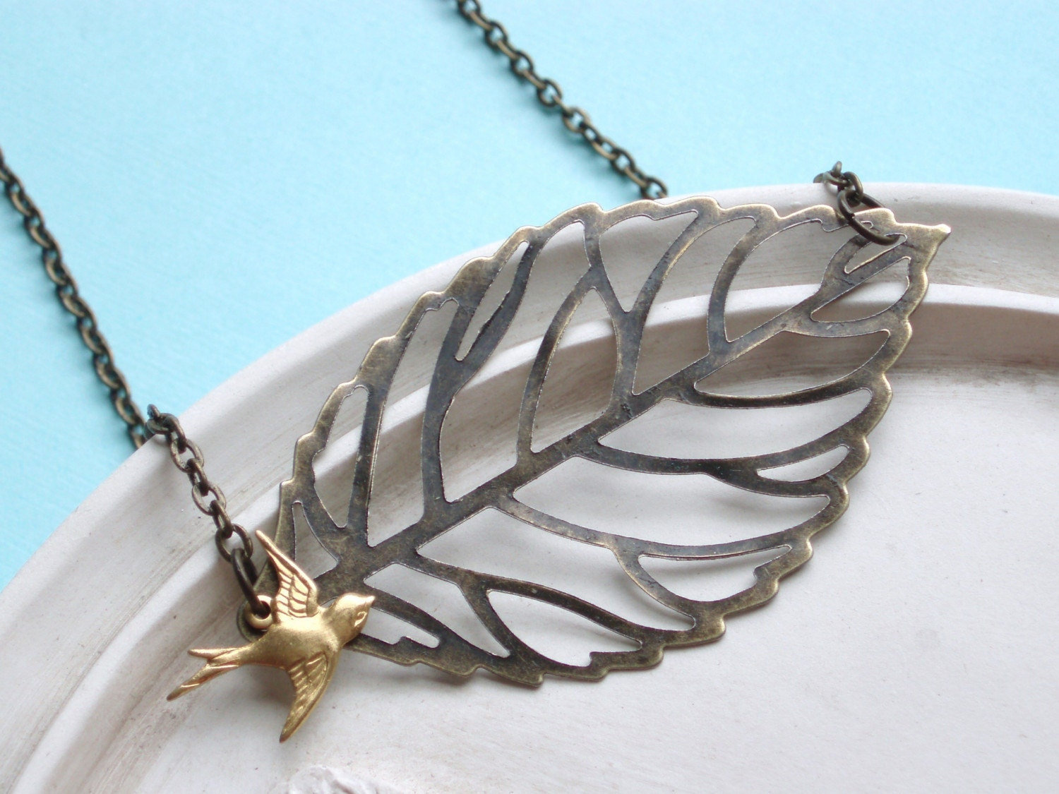Flying Free - Brass Bird and Leaf Necklace