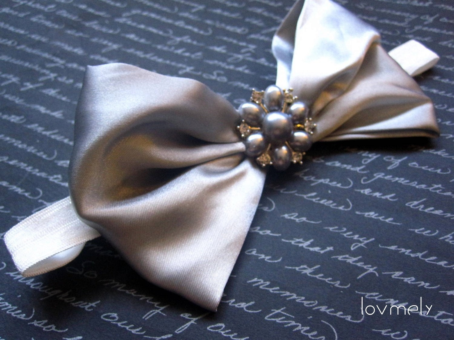 FOXY silver bow stretch headband