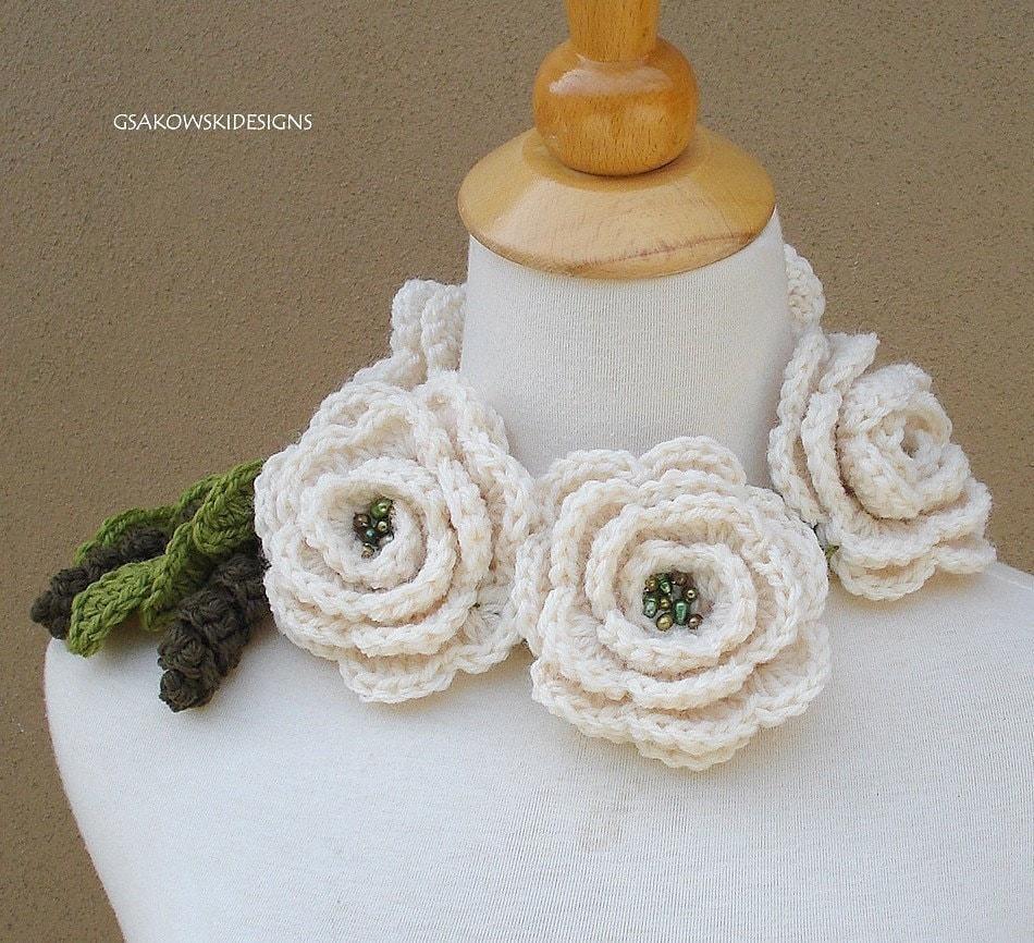 Three white knit roses scarflette, via Etsy: gsakowskidesigns