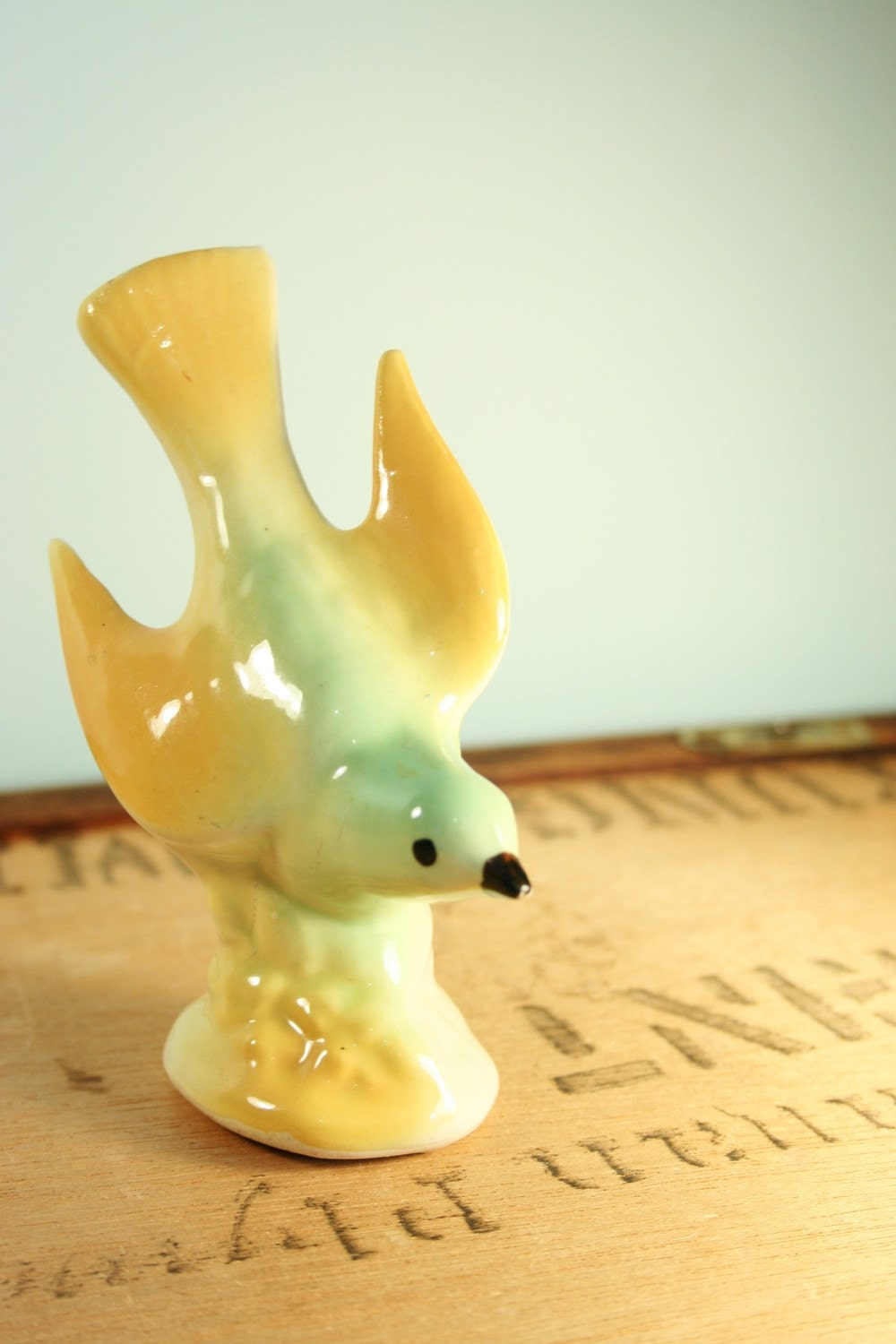 green and gold bird figurine