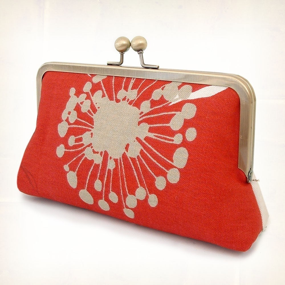 Poppy central silk-lined clutch bag