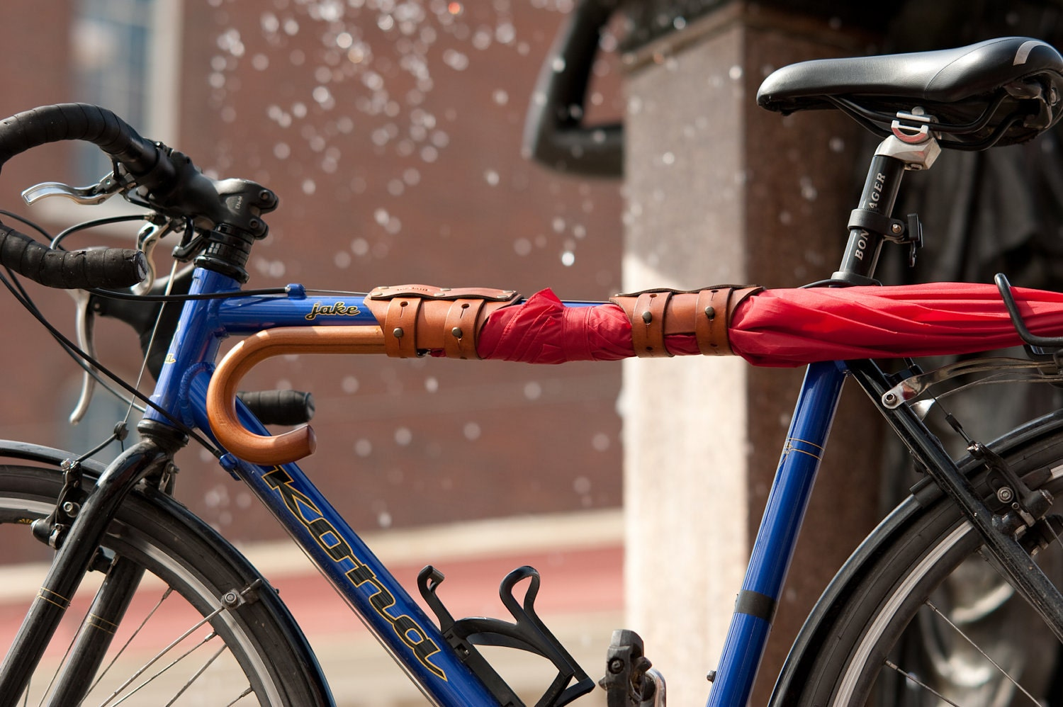 bicycle leather cinch to hold umbrellas and 6 packs of soda or beer