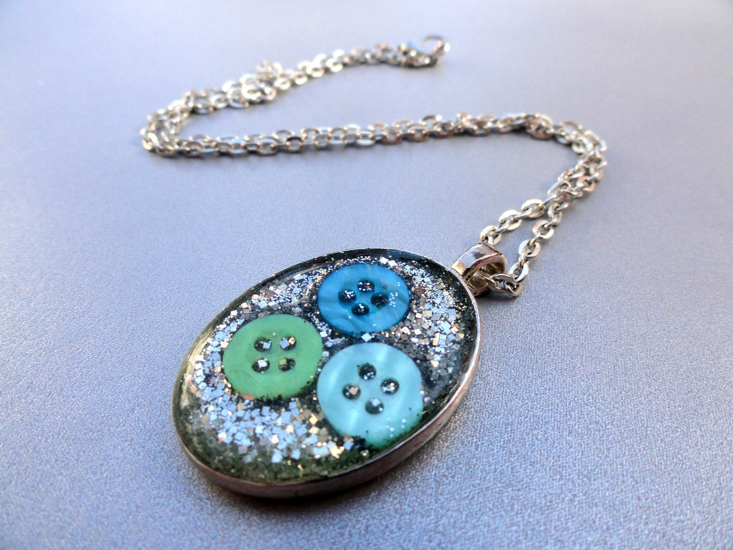 Ice Cold Resin Pendant with Silver Glitter and Icy Buttons