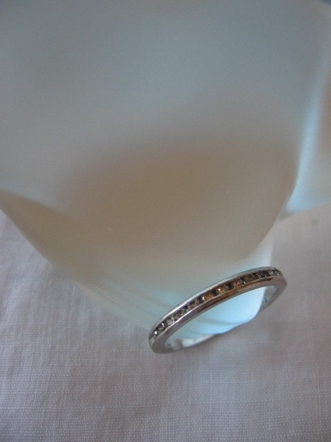 Circa 1930 diamond and platinum half eternity band