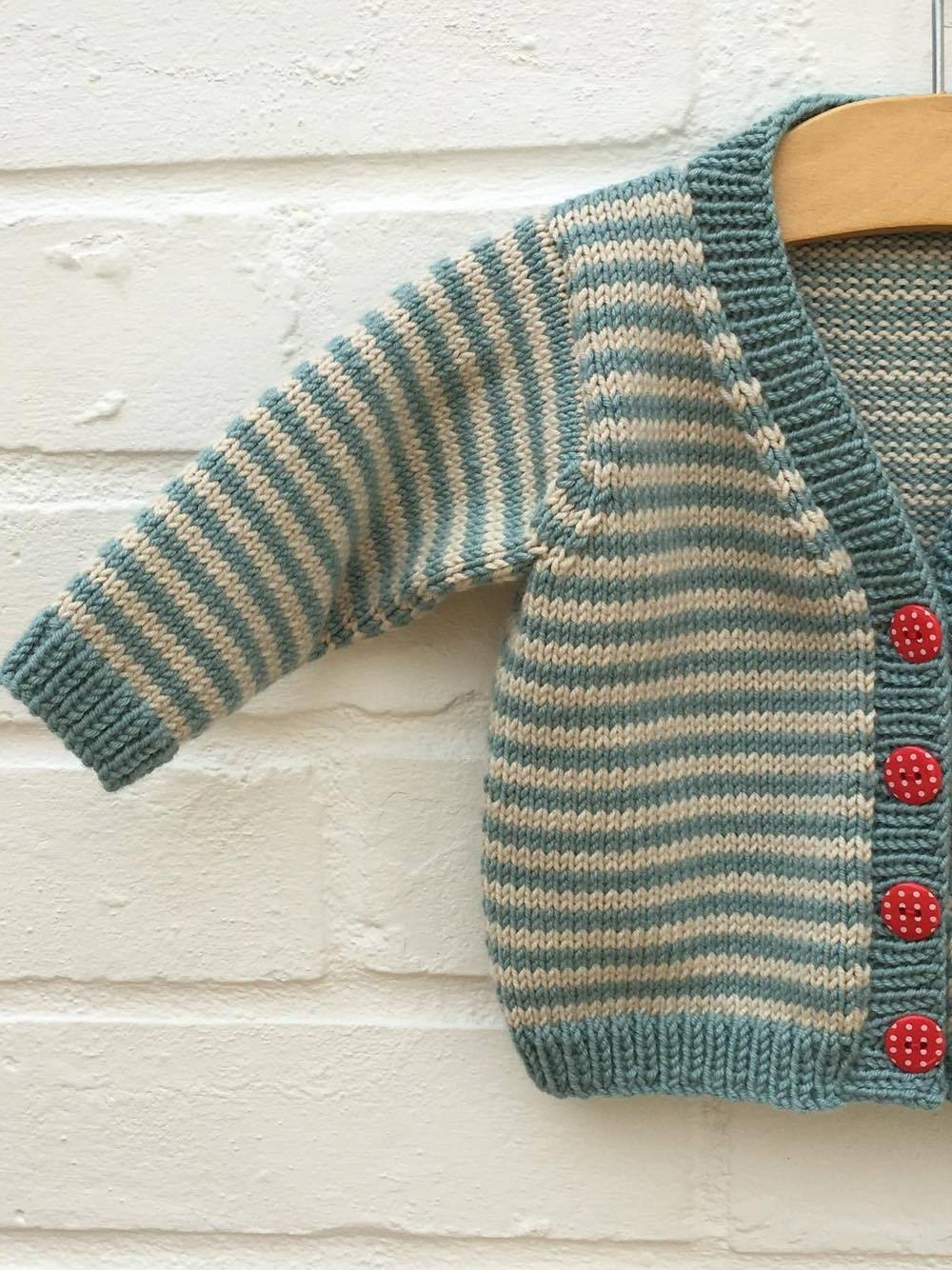 Hand knitted stripey teal and clotted cream baby cardigan  Available to order in sizes 36 69 912 and 1218 months