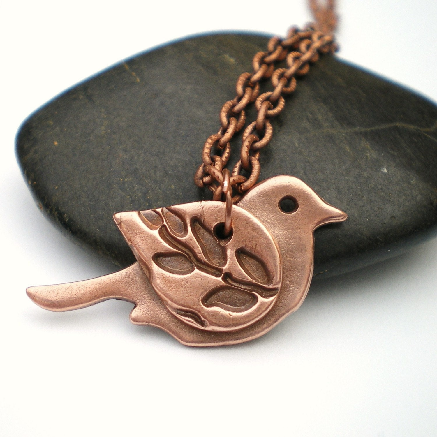 Copper Bird Leaf Pendant handmade in the UK, flies internationally