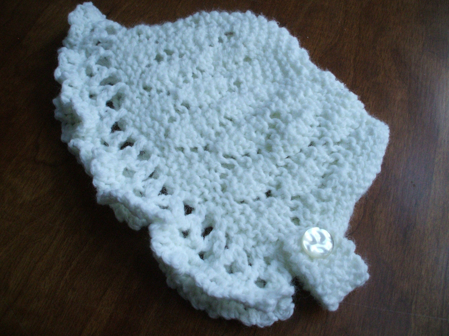 white hand knitted baptismal bonnet three to six months