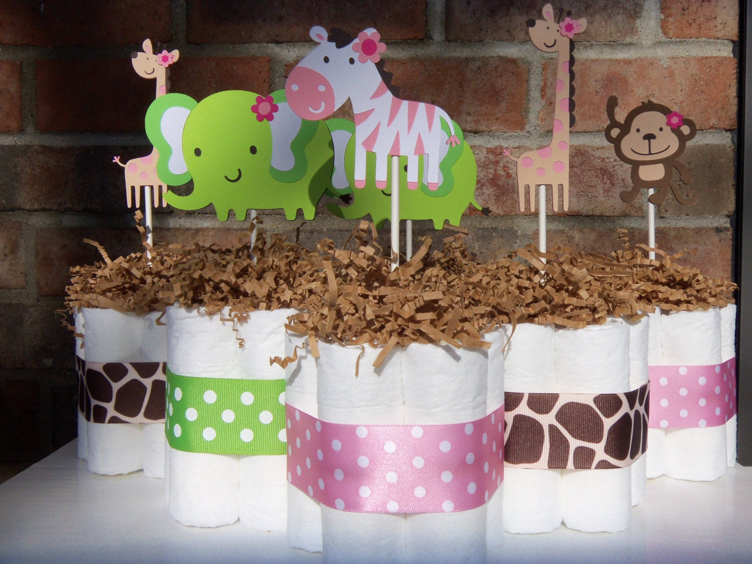 Diaper cakes jungle jill themed set of 6 by judebugsbabysweets for Baby shower jungle theme decoration ideas