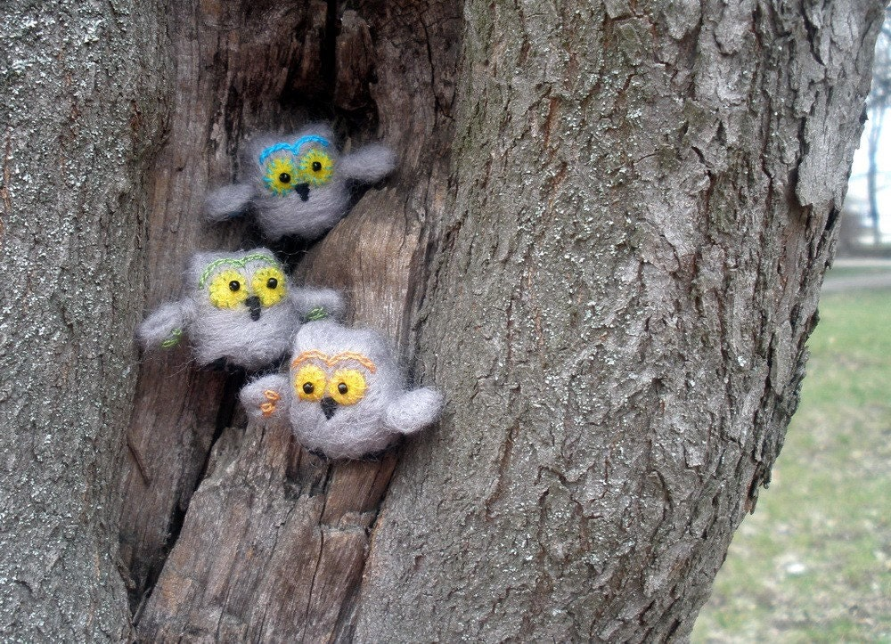 Tiny grey felted owls say Hello