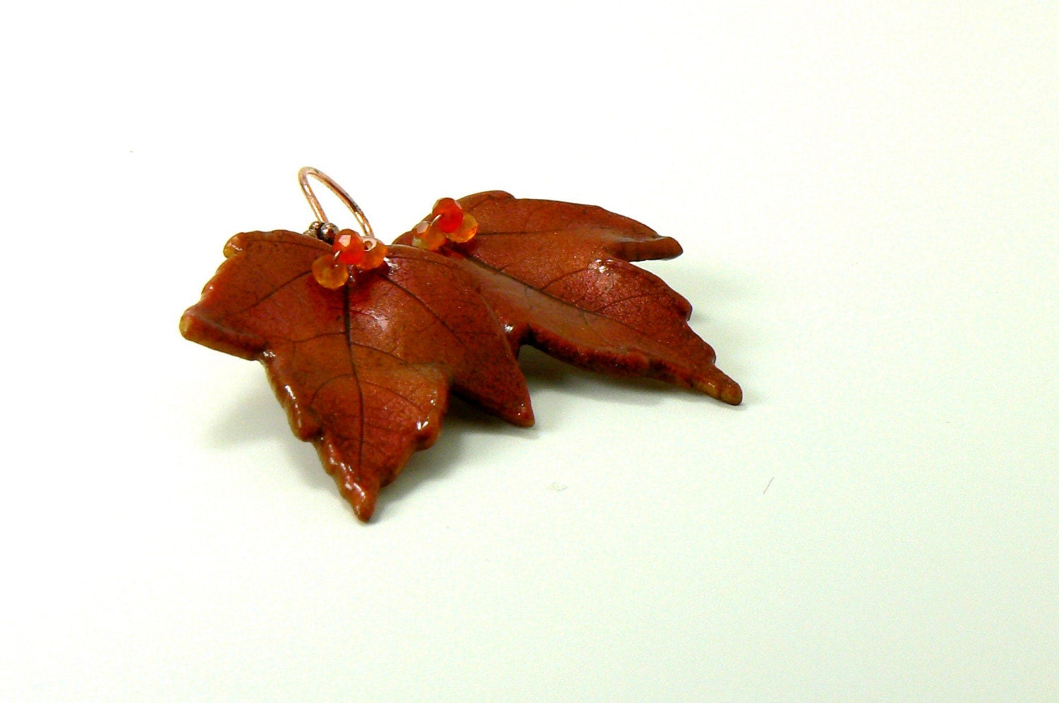 copper and carnelian maple leaf earrings by ElysianFields on Etsy from etsy.com
