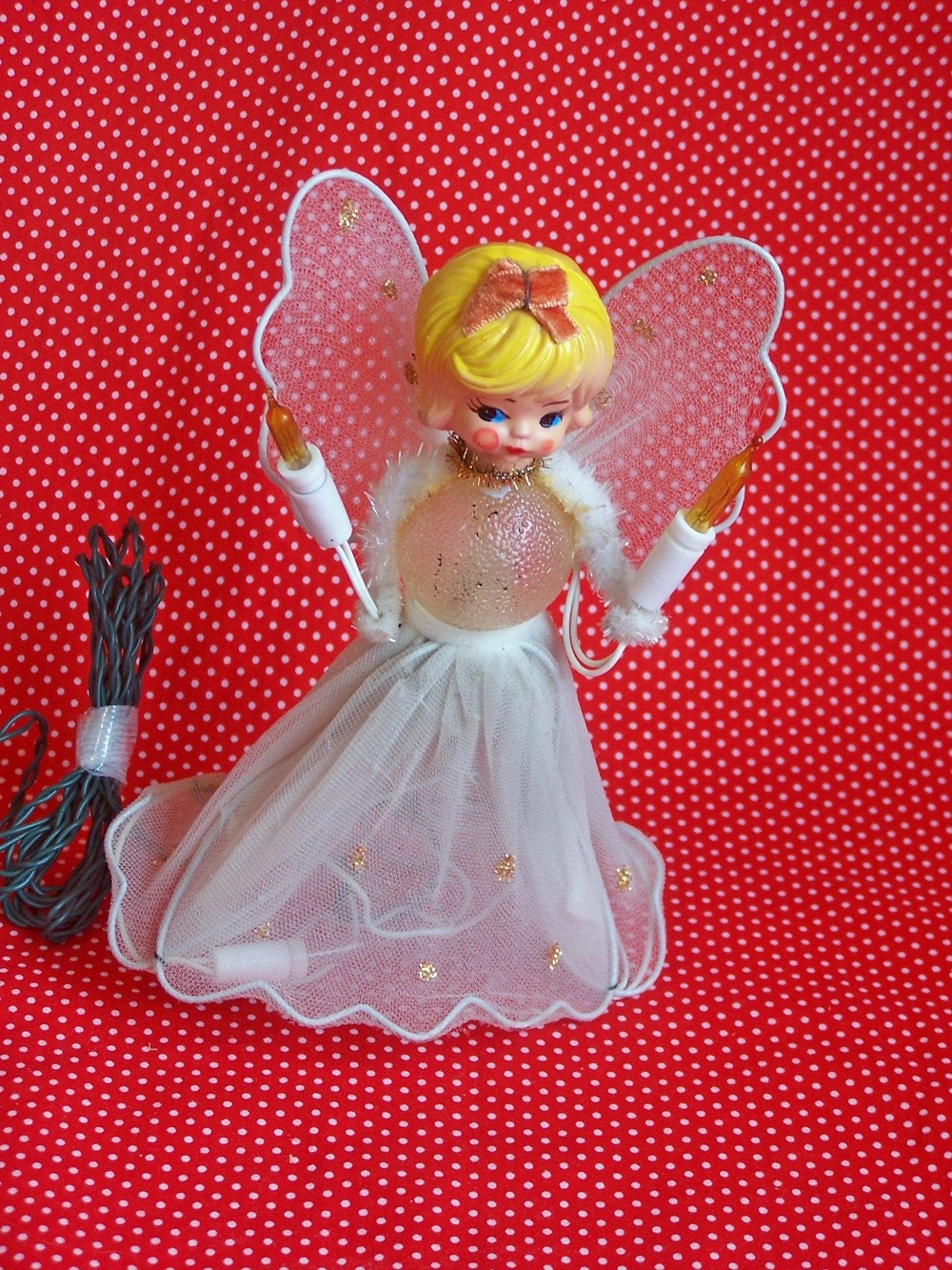 topping the tree....vintage light up Christmas angel tree topper