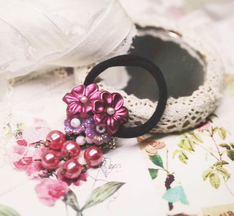 flower ponytail holder. Modest plum flowers ponytail