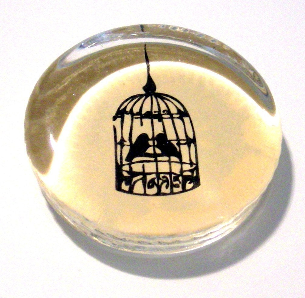 Birds in a cage paperweight