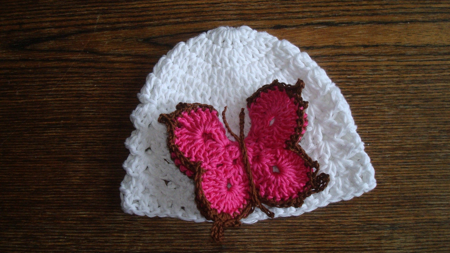 Snow white cotton hat  with big crocheted 2-layers butterfly. 0-12 month. Perfect for a gift or for a photo prop. Item 048.