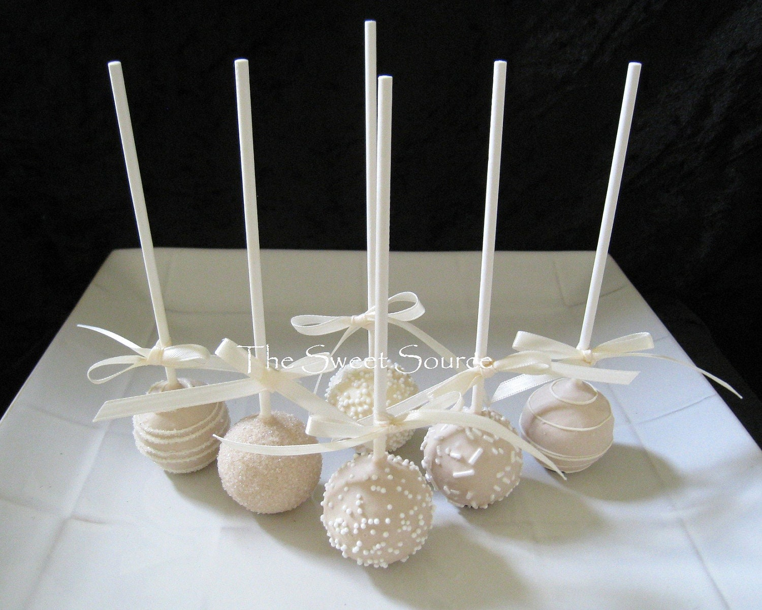Wedding favors wedding cake pops made to by thelollicakesbakery