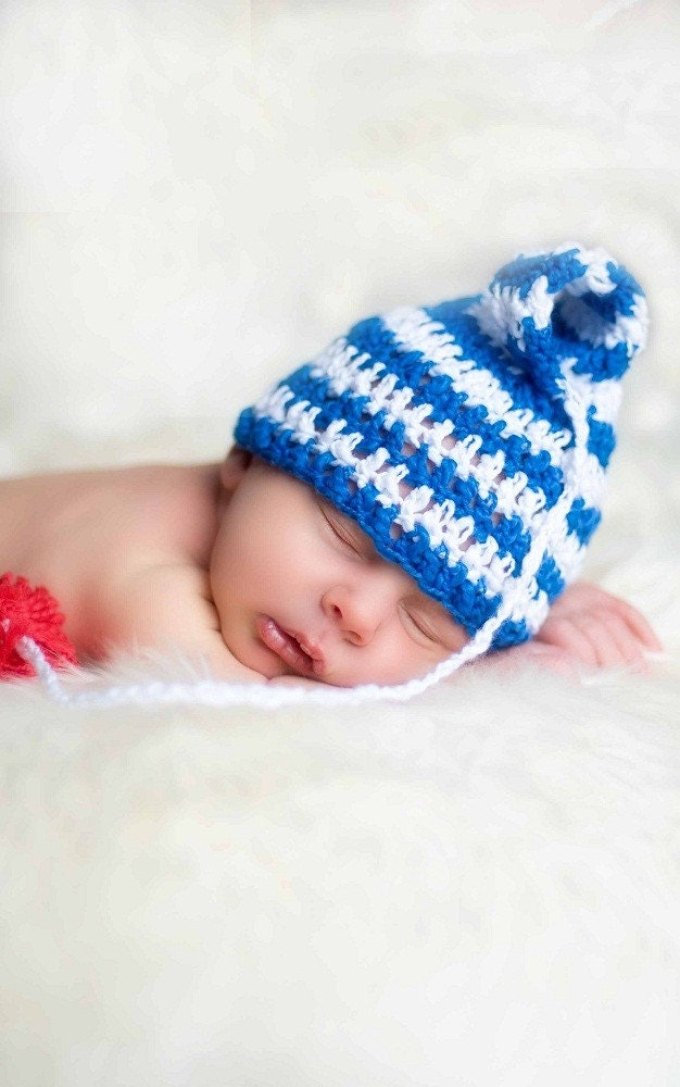 Blue and white striped Elf hat with red pom pom. 0-12 month. Great for a newborn photo prop or for a gift. Item 063. Sailor