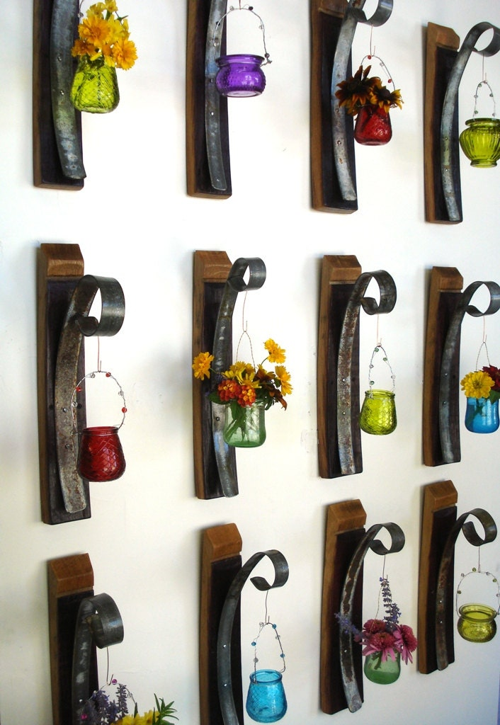 recycled wine barrels repurposed into wall hanging fixtures
