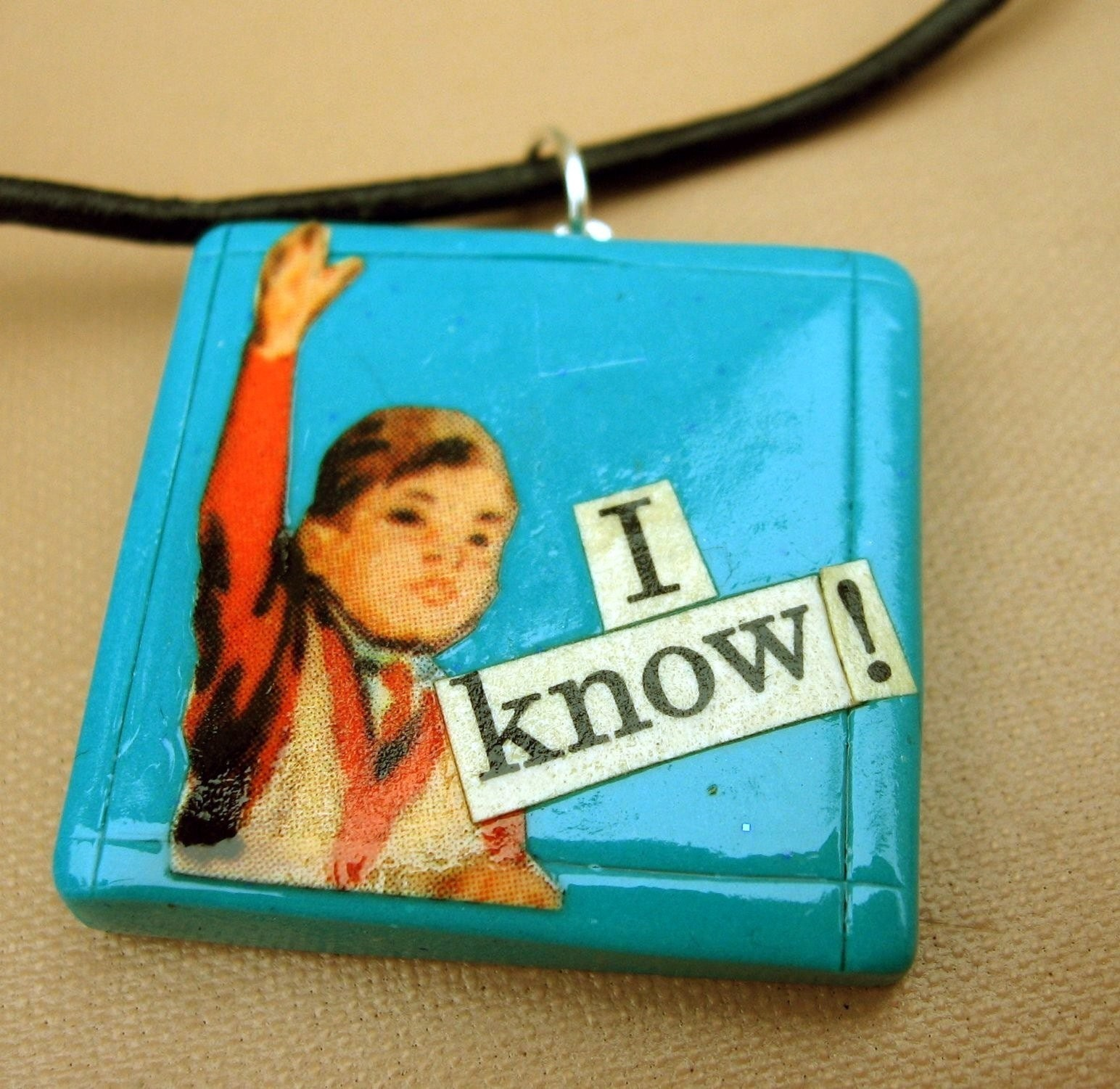 I Know pendant (on leather cord)