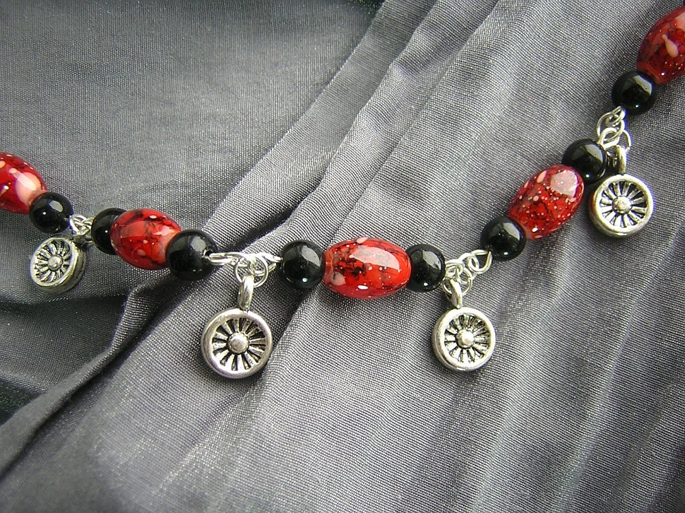 Orange and Black Beaded Necklace with Silver Wheel Charms