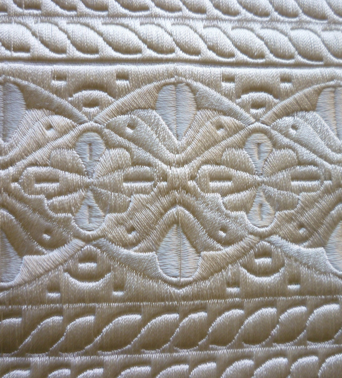 Cream embroidered art silk stiff fabric