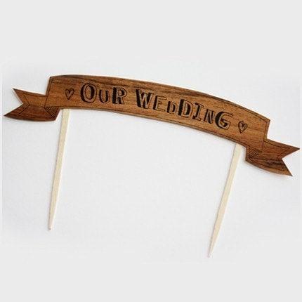 As seen in MARTHA STEWART WEDDINGS WOOD cake flag banner