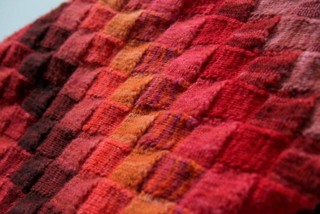 Hand Knit Entrelac Blanket in 25 Shades of Red Orange Wine Ochre and Brick Colors. Pure Merino Hand Dyed Soft Wool to the touch. - evelynWpolitzerKnits