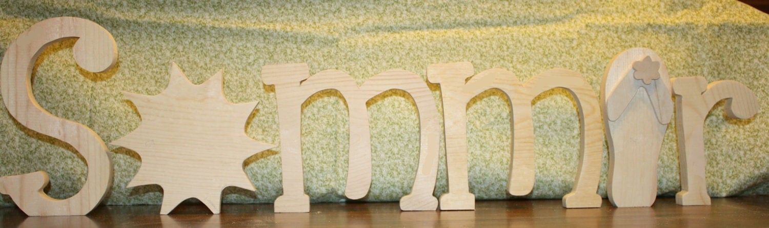 """UNFINISHED Summer wood letters has a sun as the """"U"""" and a flip flop as the """"E""""."""