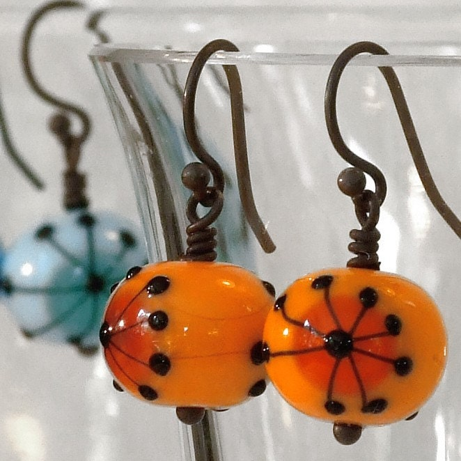 Retro hogweed earrings in citrus orange