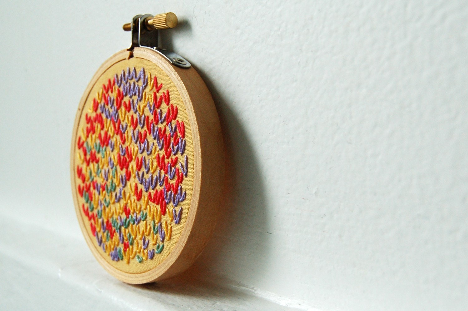 Hand Embroidery in 3 inch Hoop. Orange, Purple, Yellow. Wishbone Stitch Color Circle. West Coast Sun. Handmade by Merriweathercouncil on Etsy