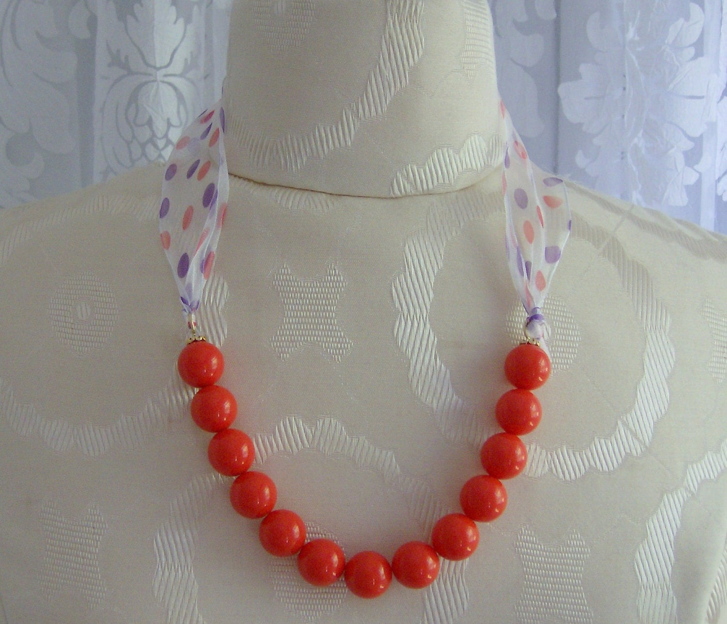 Orange coral polka dot ribbon necklace