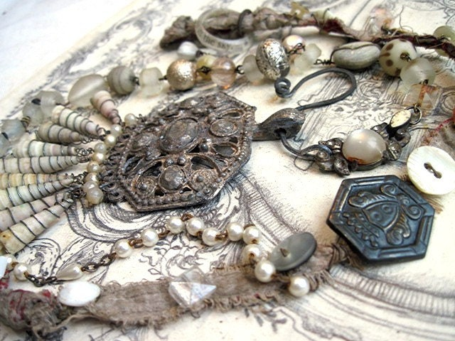 A tiny tiny grain of sand in the sky. Beach bits and Turkoman Necklace.