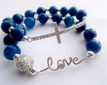 silver sideways cross, love bracelet, blue gemstone