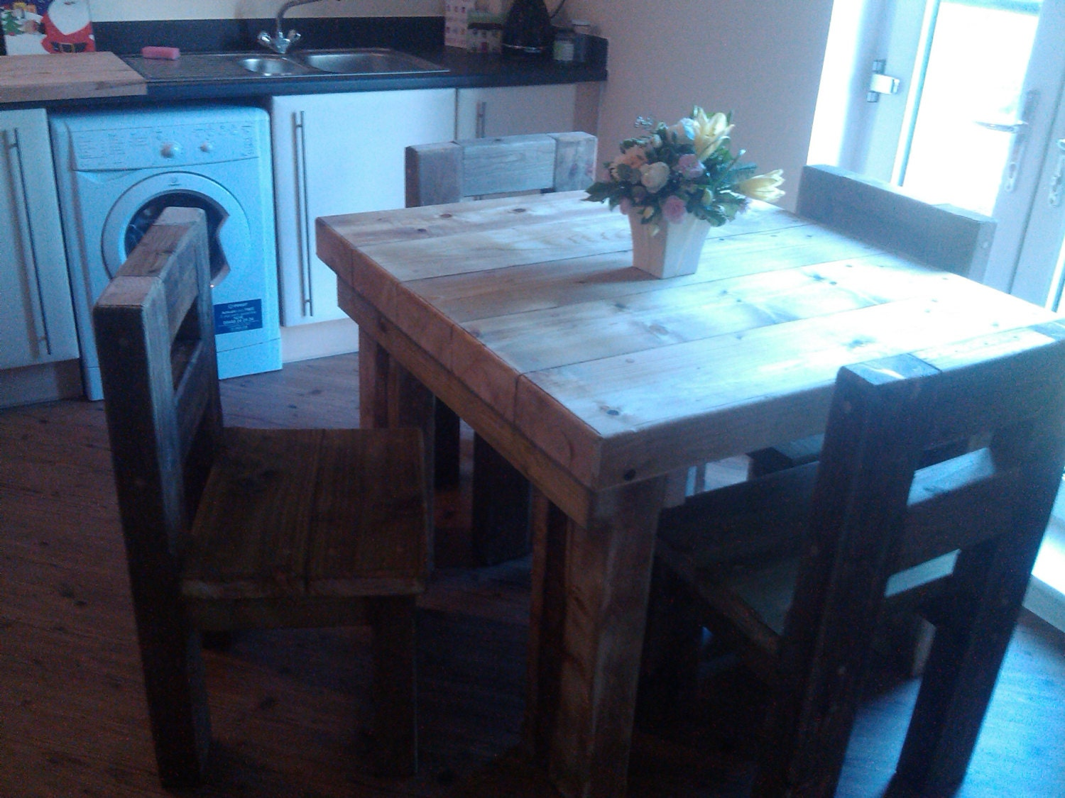 Chunky solid wood handmade dining table garden table and four chairs. CAVEMAN FURNITURE